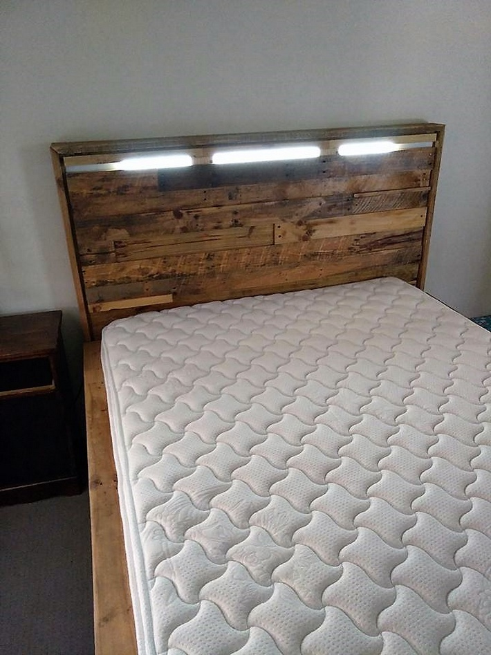 pallets bed headboard with head light