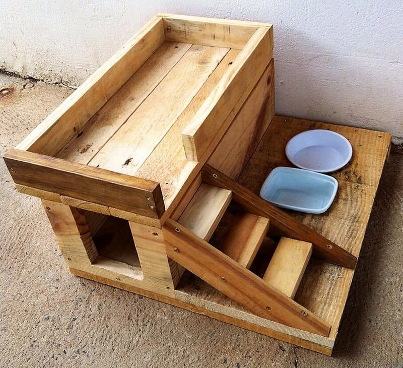 wood pallets dog house with food bowls