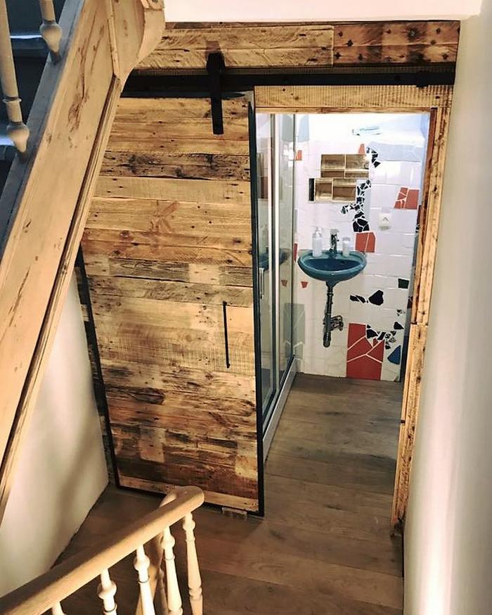 Wood pallets wall art and sliding door for bathroom wood pallet furniture